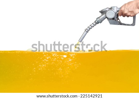 Hand holding a classic fuel nozzle pumping a gasoline fuel gold liquid in a tank of oil Industry isolated on white background with clipping path - stock photo