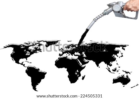 Hand holding a classic fuel nozzle pumping spilling out fossil fuel liquid crude as a map of the world as an energy concept of international commodities trading by the oil cartel of oil Industry   - stock photo