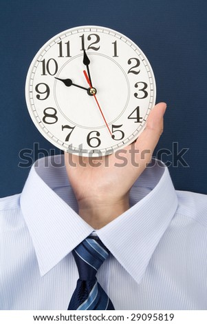 Hand holding a Clock Face, Business Concept