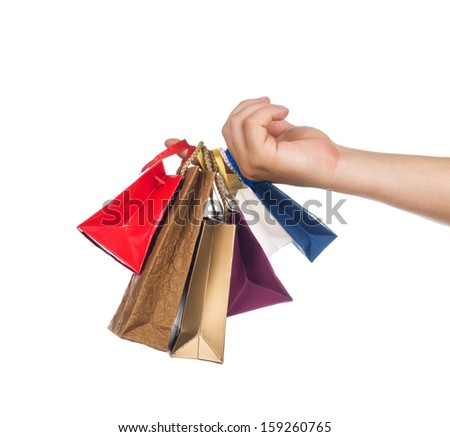 Hand holding a colorful shopping bags - stock photo
