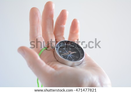 Hand holding a compass. Travel lifestyle concept. copy space