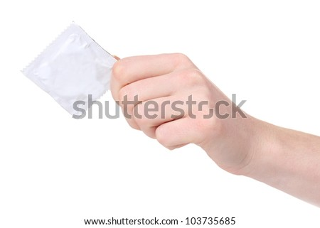 Hand holding a condom isolated on white - stock photo