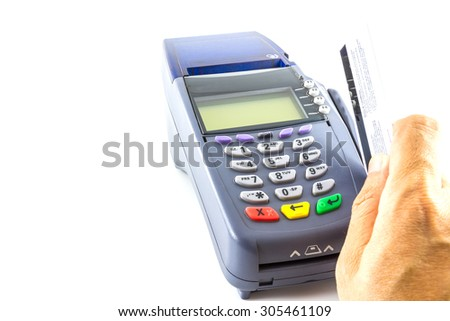 hand holding a credit card with credit card machine isolated on white background - stock photo