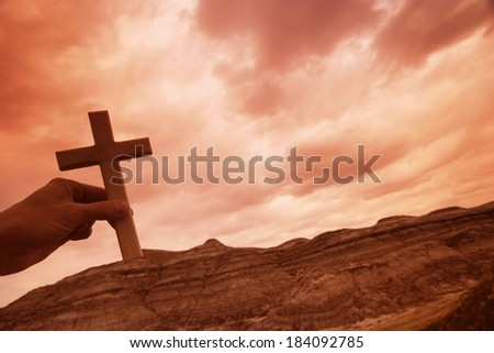 Hand Holding A Cross - stock photo