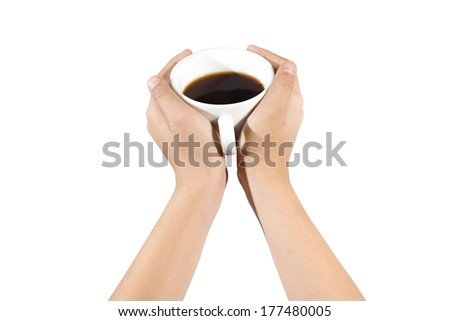 Hand holding a cup of coffee isolated on white - stock photo