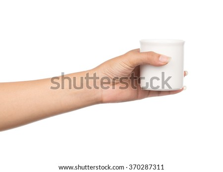 hand holding a cup of tea, isolated on white background - stock photo