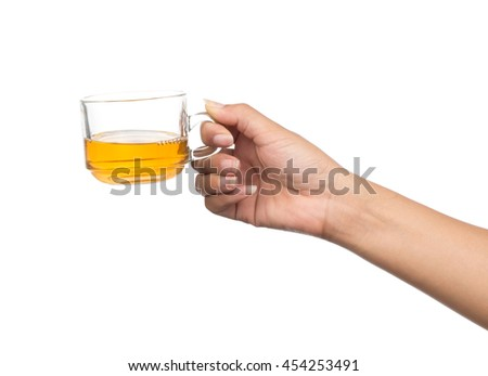 hand holding a cup of tea isolated on white background - stock photo