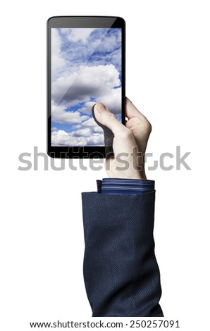 Hand holding a digital tablet with clouds on the screen   - stock photo