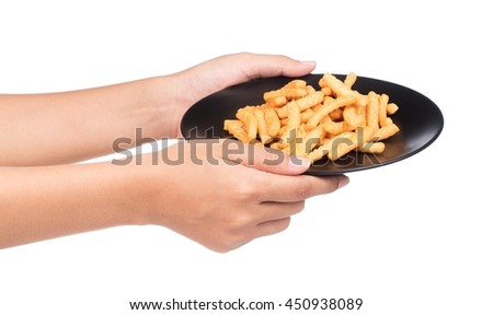 hand holding a dish of snacks isolated on a white background
