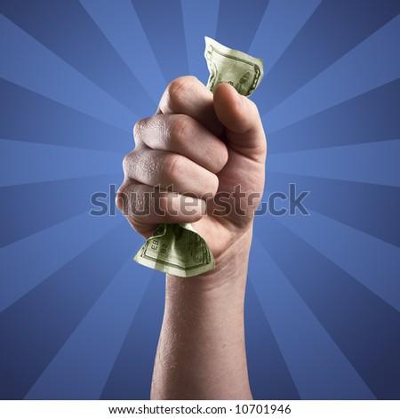 Hand holding a 20 dollar bill