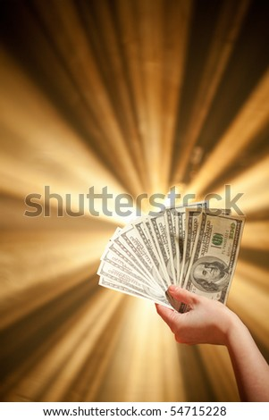 hand holding a 100 dollars banknotes - stock photo