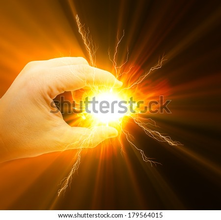 Hand holding a energy light - stock photo