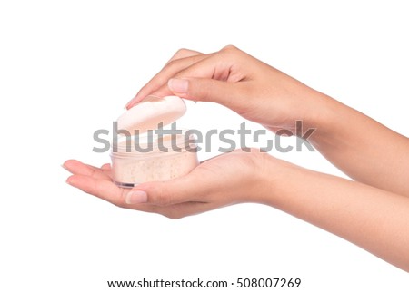 Hand holding a face powder sponge Isolation on white background.