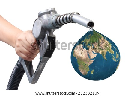 hand holding a gasoline classic fuel nozzle giving a globe oil drop isolated on white background with clipping path Elements of this image are furnished by NASA - stock photo