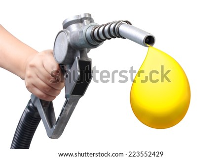 hand holding a gasoline classic fuel nozzle giving a oil drop isolated on white background with clipping path - stock photo