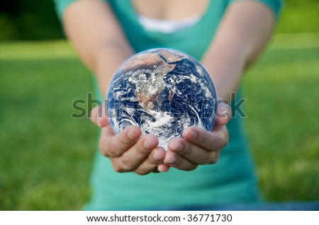 Hand holding a globe. Save Earth Environment - stock photo