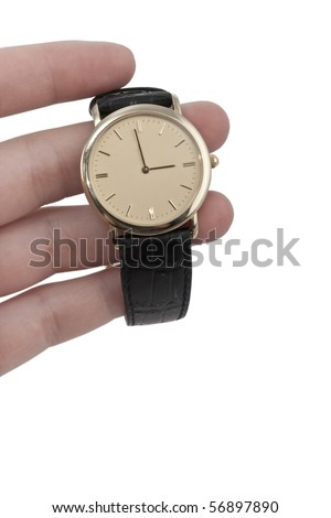 Hand holding a gold watch - stock photo
