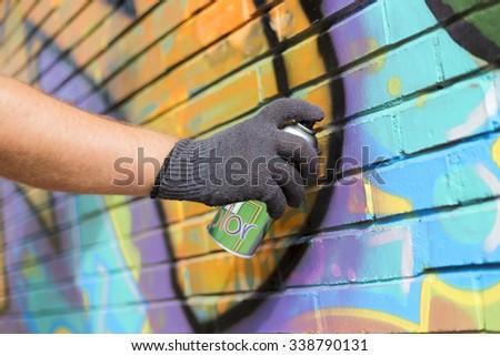hand holding a graffiti spray - stock photo