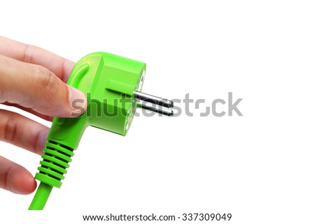 hand holding a green electricity plug - Green energy concept                                 - stock photo