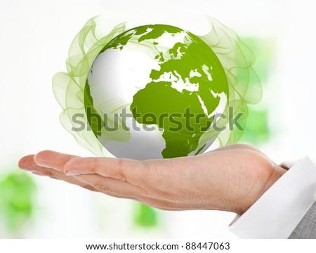 Hand holding a green globe - stock photo