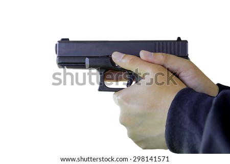 hand holding a gun on white background (soft fogus) - stock photo