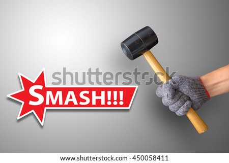 Hand holding a hammer - stock photo