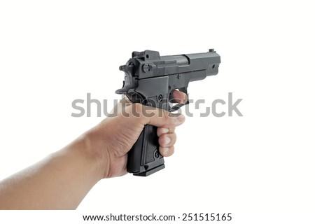 hand holding a handgun - stock photo