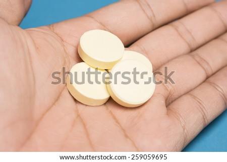 hand holding a heap of pill - stock photo