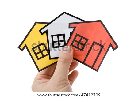 Hand holding a home sign, Real Estate Concept - stock photo