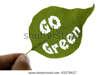 Hand holding a leaf with go green message - concept shot - stock photo