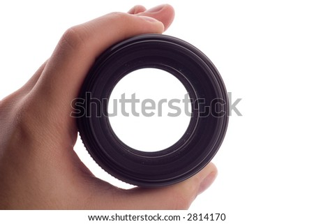 Hand holding a lens - stock photo
