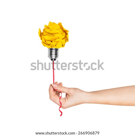 Hand holding a light bulb of crumpled paper light bulb metaphor for good idea - stock photo