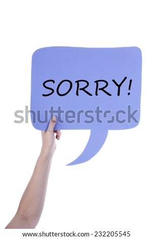 Hand Holding A Light Purple Speech Balloon Or Speech Bubble With Sorry. Isolated Photo - stock photo
