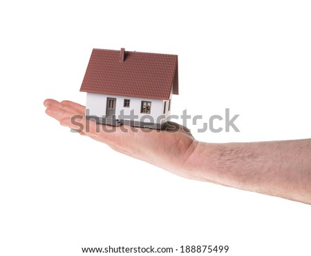 Hand holding a little house over a white background / little House - stock photo