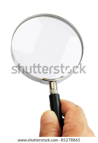 Hand holding a magnifier lens isolated in a white background