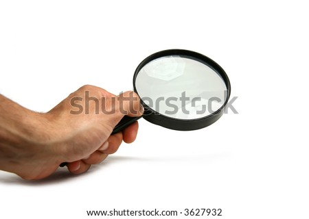 Hand holding a magnifier on white background