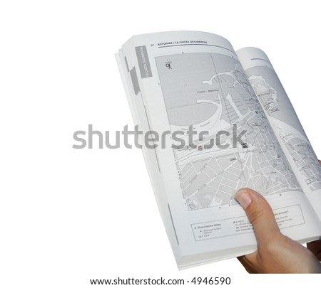 Hand holding a map - focus on map. Includes clipping path. - stock photo