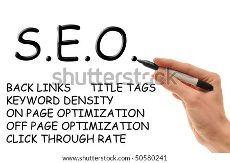 Hand holding a marker writing down the essentials of Search Engine Optimization, also known as SEO and S.E.O. - stock photo