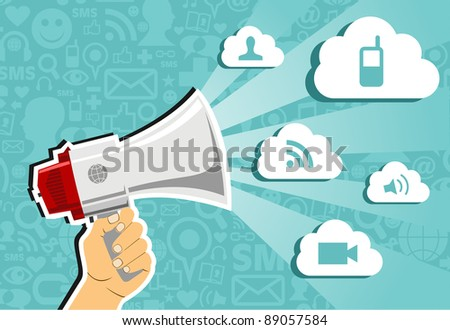 Hand holding a megaphone throwing clouds of communication on blue background with social media icons. - stock photo