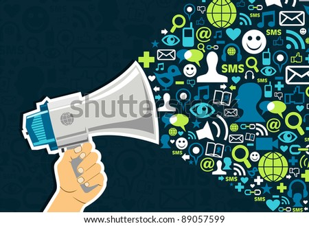 Hand holding a megaphone throwing social media icons on blue background. - stock photo