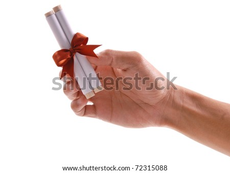Hand Holding a Message Scroll with Copper Ribbon