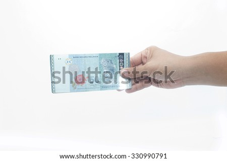 Hand holding a money isolated on a white background - stock photo
