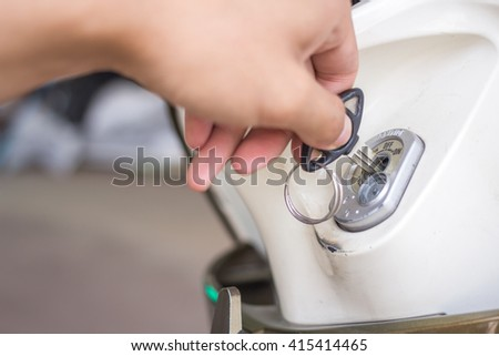 hand holding a motorcycle key
