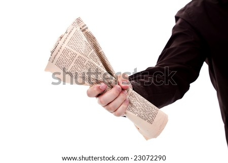 hand holding a newspaper - stock photo