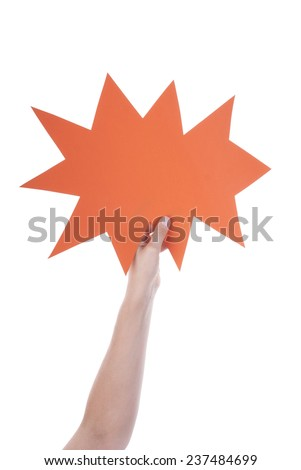 Hand Holding A Orange Empty Speech Balloon Or Speech Bubble. Isolated Photo With Copy Space Or Your Text Here - stock photo
