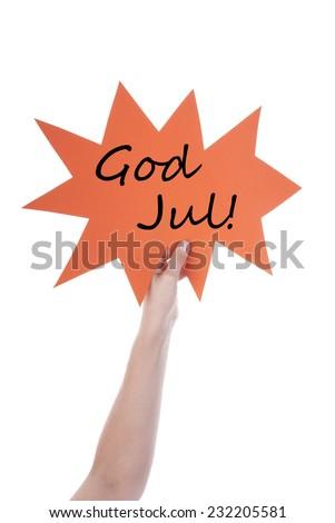 Hand Holding A Orange Speech Balloon Or Speech Bubble With Swedish Or Norwegian God Jul. Isolated Photo - stock photo