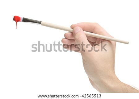 Hand holding a paint brush on white background