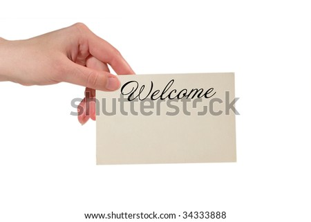 Hand holding a paper card with the word Welcome (isolated on white) - stock photo