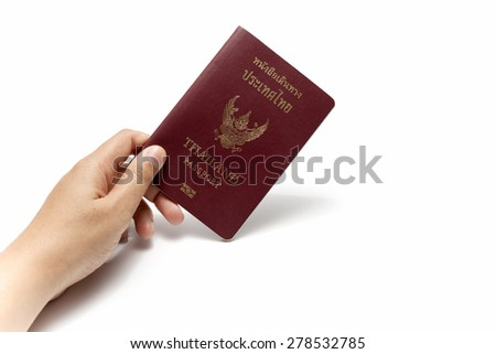 hand holding a passport isolated on white background