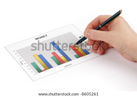 Hand holding a pen showing a diagram on financial report - stock photo